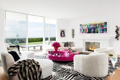 Elton John and David Furnish's Groovy Lounge // Mongolian-lamb club chairs, chincilla throw, zebra-print rug, pink lacquer coffee table