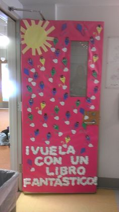 """March Classroom Door Decoration-March is reading month.  Each student put their favorite book on a cloud next to their kite picture. """"Vuela con un libro fantastico"""""""