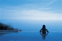 Infinity pool - A swimming pool whose positioning gives the impression that it merges into the surrounding landscape. Often overlooking a body of water, such as a river or bay, or on a hillside or cliff.
