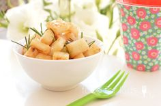 Sauté potatoes in a white bowl