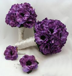 This purple anemone silk flower wedding package includes a bridal bouquet, grooms boutonniere, maid of honor bouquet & best man boutonniere in