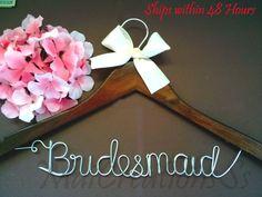 WEEKEND SALE. Personalized Bridal Wedding Hanger. Bridal Hanger. Bridal Party. Custom Hanger. Comes With Bow. $9.99, via Etsy.