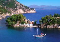 Sailing in summer- Beautiful Parga. The water really is that blue.