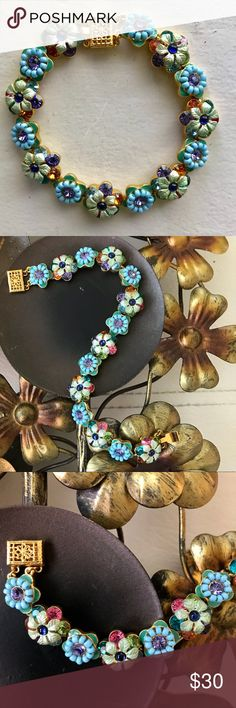 """Joan Rivers Jewelry Floral Bracelet Absolutely stunning! This colorful bracelet features floral stations comprised of beads, crystals and enameling. Gold tone hardware. Main colors are blue, green and lavender. Accented with pink, orange and teal as well. Approximately 7 1/4"""" in length. Filigree box clasp. Even more beautiful in person! Never worn. Thanks for looking! Joan Rivers Jewelry Jewelry Bracelets"""