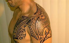 polynesian chest shoulder tattoo