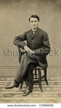 CIRCA 1865 - A vintage Cartes de visite photo of a gentleman. The man is sitting with one arm on the arm of the chair. A photo from the Civil War Victorian era. A digital copy can be purchased at the above web link.