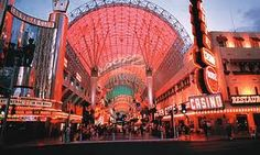 Fremont Street Experience.  Downtown casinos are joined together under the Viva Vision canopy creating a pedestrian mall lined with shopping and performers.  It is non-stop entertainment beginning at dusk.