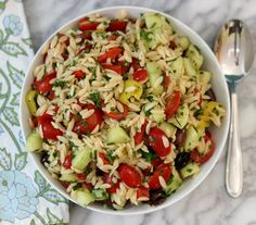 Greek Orzo Pasta Salad - A light refreshing greek salad made with orzo pasta, cucumber, tomatoes, peppers and seasoned with lemon juice and fresh herbs.#createwithcrisp