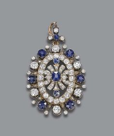 AN ANTIQUE SAPPHIRE AND DIAMOND PENDANT   Of openwork design, the central sapphire and diamond motif to the sapphire and diamond collet surround and suspension loop, mounted in silver and gold, with brooch fitting, circa 1880, 6.0 cm. high, in original purple velvet fitted case
