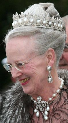 an older Queen Margarethe in pearlsshe is archaeologist  participated in excavations