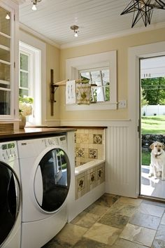 Mud room with laundry facility and mini dog shower (also can use for washing boots, watering plants, etc.)