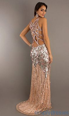 Make a dazzling impression at prom or formal in this one of a kind full length v-neck sequin formal gown by Primavera. A unique long sequin dress with a low V-neckline and amazing detailing across the seductive low cut open back. Glittering silver sequins on a Champagne back ground are featured in an eye-catching diamond pattern for a sexy silhouette to this stunning V-neck sequin formal dress.
