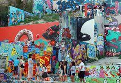 Visitors to Austin's Graffiti Park make their way up and down the vibrant display. Photo by Silvana Di Ravenna