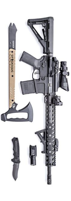 Centurion Arms CMR upper with Mega Arms lower, Magpul, Trijicon ACOG, offset is from Vortex Optics. The light is a SureFire X300U, the blades are Gerber Gear. Photo by Stickman.