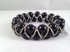 Gorgeous Goddess bracelet made with glass pearl beads & Tibetan silver links.