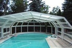 A pool framed among beautiful trees with Libart!