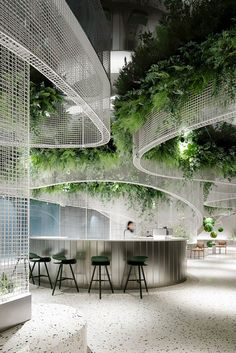 karv one installs flowy metal ceiling fixture within dreamy café interior in china