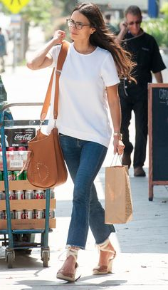 Jordana Brewster in a white T-shirt, kick-flare jeans and wedges - click ahead for more summer outfit ideas from celebrities