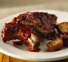 Make a favorite comfort food right in the slow cooker! These tangy barbecue ribs are sure to be a hit with your family. The recipe makes 8 servings, so it's perfect for larger gatherings (or if you want to make sure you have leftovers). To save time, use 2 2/3 cups bottled barbecue sauce in place of the from-scratch recipe.