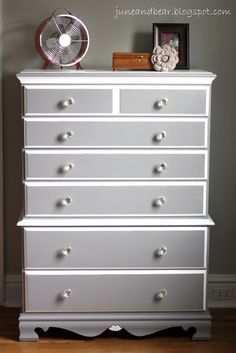 A chest of drawers similiar to the one in my bedroom painted white and pewter and with new hardware.  I could do this!