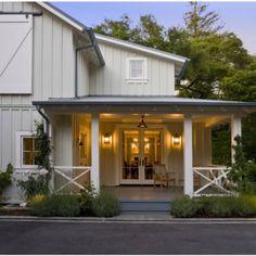 modern farmhouse exterior | front porch + barn door windows