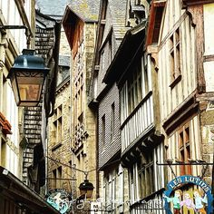 The narrow streets of the Mont Saint Michel in Normandy France with its very cute houses  #architecture #houses #house #housestyle #streetstyle