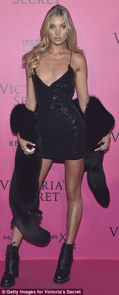 Victorias Secret Parade 2016 Elsa Hosk sported a belted black mini dress and chunky heeled boots...