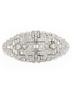 Platinum and Diamond Double Clip-Brooch | lot | Sotheby's