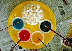 Painted popcorn for kids art party. sweetened evap. milk + food coloring = edible paint. super cute.