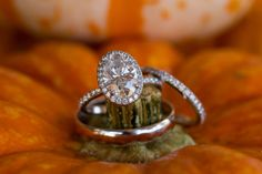 Oval-cut diamond engagement ring with halo and thin pave diamond band {Jennifer Weems Photography}
