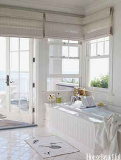 The master bath opens to an oceanside deck.