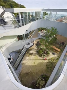 This is an interesting home in Japan. The house is built above the yard.