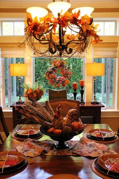 autumn dining room....love the chandelier