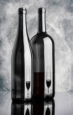 Still life with two bottles and reflections of wine glass