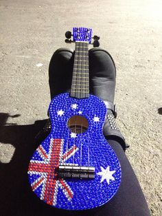 This is a ukulele that I bedazzled for the singer p! I gave it to her on her last record breaking melbourne show. Ukulele Art, Flutes, My Passion, Pretty Pictures, Guitars, Melbourne, Skateboard, Instruments, Sparkle