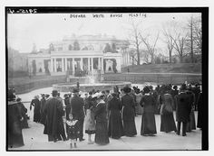 Photo shows crowd outside the White House on the wedding day of Jessie Woodrow Wilson, daughter of President Wilson who married Francis Bowes Sayre in a White House ceremony on November 25, 1913.