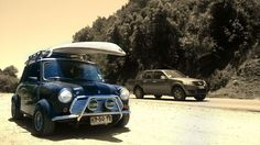 Classic mini with roof rack surf paddle