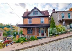 Own a sweet little timeless Victorian home with a covered front porch at the end of the street. With classic interior and modern amenities including a grand foyer featuring a ceramic tile entry, exposed woodwork and pocket doors, this house is a perfect blend of old and new.   #Pittsburghrealestate #MtWashington