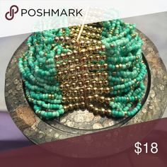 Nice, turquoise and gold tone bracelet Nice, multi-strand turquoise and gold tone, stretchy, beaded bracelet. Can be worn with jeans or dress.{025} Jewelry Bracelets