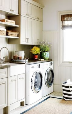 like the layout here: washer/dryer, then sink, then counter...max cabinets above, but do open shelving just above sink/counter