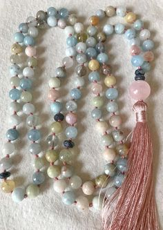 100% All natural Aquamarine, Beryl, Heliodor and Morganite Mala Beads. Not dyed or heat treated. Gorgeous combination of pastels. Heart and Throat Chakra Mala Beads, Expression, Assertive Communication, Intuition. March Birthstone. Vishudha Chakra means poison removing. This Chakra