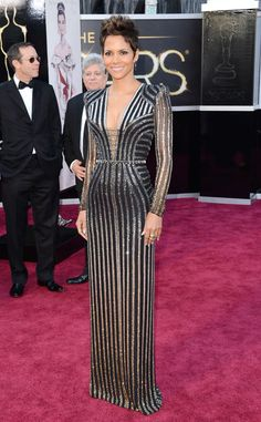 Red Carpet Glam from Fashion Spotlight: Halle Berry  Bond girl alert! Halle wore a striped, metallic, custom Versace gown—with major va-va-voom neckline—to the 2013 Oscars.