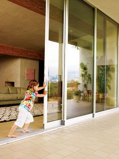 Glass wall that is stackable to create an open space connecting living room to outdoor living space/patio.