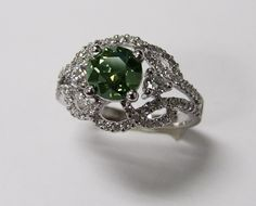 This is a special ring.. how?? Well, this is no emerald, but a green irradiated DIAMOND! -Available at Hunt Valley Jewelers