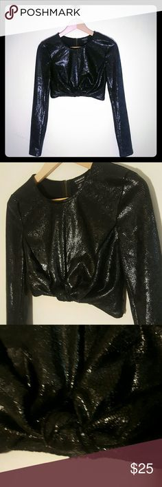 Snakeskin-like long-sleeved crop top. Knotted at bust. Full zipper in the back.100% Polyester Hommage Tops