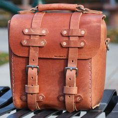 Rugged and simple are two words that accurately describe The Adams Camera Bag. Made from nine to ten ounce (that's belt thick leather), full grain, vegetable tanned Hermann Oak cowhide, The Adams is b