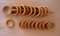 Inexpensive play idea. Wooden curtain rings and a wooden spoon.