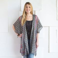 This sheer kimono is perfect for dressing up a simple tank top and jeans or throwing over your bathing suit! It's the perfect finishing layer to all of your looks! •Machine wash cold, tumble dry low. •100% Polyester. •Loose fit. Hem falls just above the knee. Wide half-sleeves. Sheer fabric.