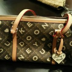 Small purse can be used as a cross body purse New without tags Dooney & Bourke Bags Crossbody Bags