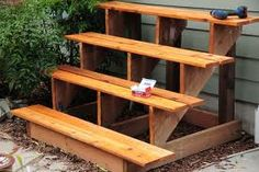 Tiered plant stand constructed re-purposed shelves